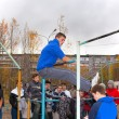 Stock Photo: Youth movement workout on horizontal bar
