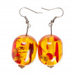 Earrings in glass yellow- red on a white background — Stock Photo