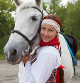Portrait of a girl next to a white horse — Stock Photo