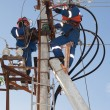 Electricians troubleshoot on power lines — Stock Photo