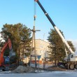Stock Photo: Installing a power pole with the use of special equipment