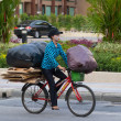 Stock Photo: Patong - APRIL 26: Thai womtakes out garbage in bags on