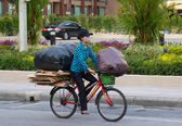 Patong - APRIL 26: Thai woman takes out the garbage in bags on — Stock Photo