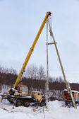 Construction of power lines using a mobile crane  — Stock Photo