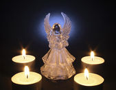Angel with tea lights — Stock Photo