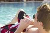 Relaxing by the pool — Stock Photo