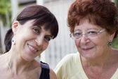Two women friends smiling — Stock Photo