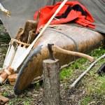 Old Ax with canoe — Stock Photo #11501203