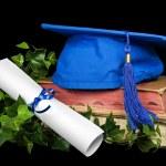 Blue graduation cap on books — Stock Photo
