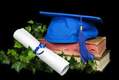 Blue graduation cap on books — Stock Photo