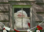 Santa mit Strümpfen — Stockfoto