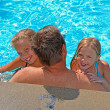 Kids with dad in pool — Stock Photo