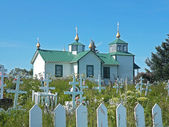 Russian Orthodox church with cemetery — Stock Photo