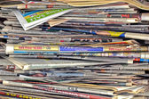 Messy stack of newspapers — Stock Photo
