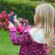 Little girl taking a photo — Stock Photo
