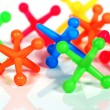 Stock Photo: Colorful toy jacks