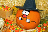 Pumpkin wearing a witch hat — Stock Photo