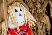 Autumn scarecrow in corn husks — Stock Photo
