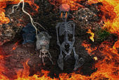 Hell fire with skeletons — Stock Photo