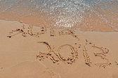 2013 nyår på stranden — Stockfoto