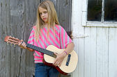 Girl with guitar — Stock Photo