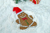 Gingerbread man snow angel — Stock Photo