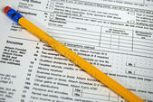Chewed pencil on tax form — Foto Stock