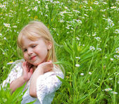 Little girl in wildflowers — Stock Photo