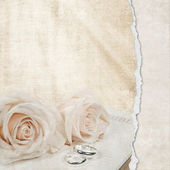 Wedding roses on Bible — Stock Photo