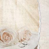 Wedding roses on Bible — Stock Photo