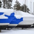 Shrink wrapped boats in snow - Stock Photo
