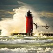 Stock Photo: Wave slamming red lighthouse