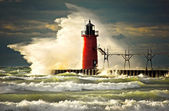 Wave slamming red lighthouse — Stock Photo