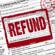 Stock Photo: Refund stamp on income tax form