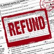 Refund stamp on income tax form - Stock Photo