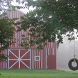 Tire swing by barn — Stock Photo #21227785