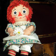 Old rag doll on suitcase — Stockfoto #24702227