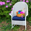 Colorful yarn basket on rocking chair — Stock Photo #26428113