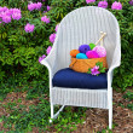 Colorful yarn basket on rocking chair — Stock Photo