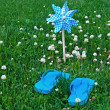 Summer flip-flops with toy windmill — Stock Photo