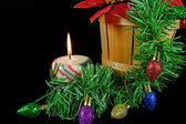 Christmas candle with garland — Stok fotoğraf