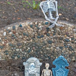 Halloween skeletons and tombstones — Stock Photo