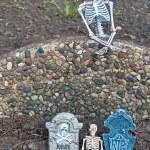 Halloween skeletons and tombstones — Stock Photo #30115935