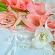 Gladiolas with wedding bands — Stock Photo