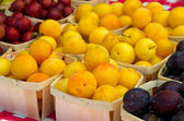 Ripe plums at the market — Stock Photo
