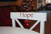 Christmas ornament on white chair — Stock Photo