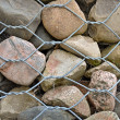 Rock wall with fence — Stock Photo