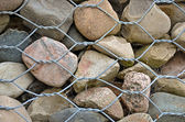 Rock wall with fence — Stockfoto
