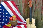 Apples and guitar with flag — Stock Photo