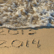 Stock Photo: New year 2014 on beach